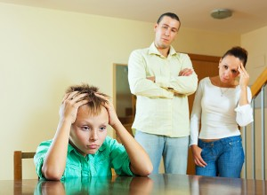 Parents and teen son after quarrel at home